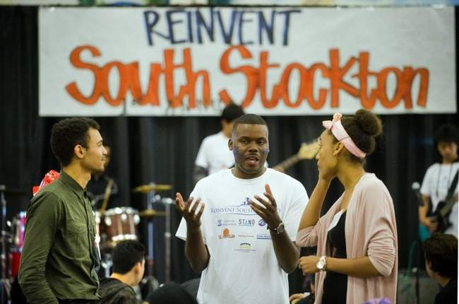 Stockton City Councilman Michael Tubbs, center, talks with Sam Sinyangwe, left, and Anna Nti-Asare at the Reinvent South Stockton summit held at the San Joaquin County Fairgrounds on April 25. CLIFFORD OTO/THE RECORD